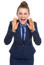 Happy business woman shouting through megaphone shaped hands high resolution photo Stock Images