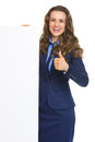 Happy business woman showing blank billboard and thumbs up isolated on white Royalty Free Stock Photography