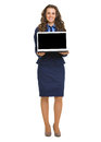 Happy business woman showing laptop blank screen full length portrait of Royalty Free Stock Image