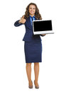 Happy business woman showing laptop blank screen and thumbs up isolated on white Stock Photos