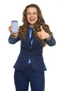 Happy business woman showing phone and thumbs up Royalty Free Stock Photo