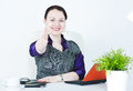 Happy business woman showing thumbs up Stock Photo