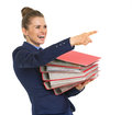 Happy business woman with stack of folders pointing on copy space Stock Image