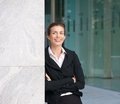 Happy business woman standing outside office building Royalty Free Stock Photo