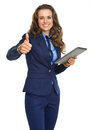 Happy business woman with tablet pc showing thumbs up isolated on white Royalty Free Stock Image