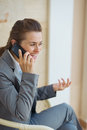 Happy business woman talking cell phone on terrace Royalty Free Stock Images