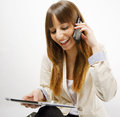 Happy business woman talking on smart phone and working on digital tablet Royalty Free Stock Image