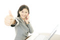 Happy business woman with thumbs up the female office worker who poses happily Royalty Free Stock Photo