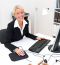 Happy business woman using computer and smiling Royalty Free Stock Photos