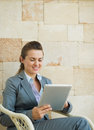 Happy business woman using tablet PC Royalty Free Stock Photo