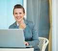 Happy business woman working on laptop Stock Images