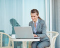 Happy business woman working with laptop on terrace Stock Photography