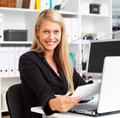 Happy business woman working in office Royalty Free Stock Images
