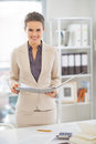 Happy business woman working in office portrait of Royalty Free Stock Photos