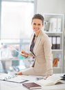 Happy business woman working in office portrait of Stock Photo