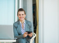Happy business woman writing text message Royalty Free Stock Photo