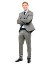 Happy businessman arms folded isolated on white background standing full length Stock Photos