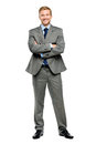 Happy businessman arms folded isolated on white young smiling Royalty Free Stock Photo