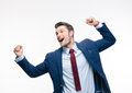 Happy businessman celebrating his success isolated on a white background looking away Royalty Free Stock Image