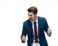 Happy businessman celebrating his success young isolated on a white background looking away Royalty Free Stock Photo