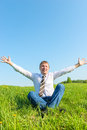 Happy businessman enjoys the sun in nature Stock Images