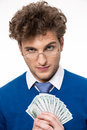 Happy businessman in glasses holding money