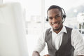 Happy businessman with headset interacting Royalty Free Stock Photo