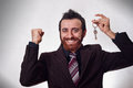 Happy businessman holding a house key Royalty Free Stock Images