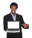 Happy Businessman Holding Laptop Royalty Free Stock Photo