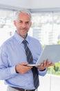 Happy businessman holding laptop Royalty Free Stock Photo