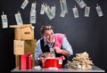 Happy businessman is laundering money banknotes in foam in red washbowl Stock Photo