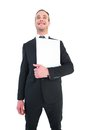 Happy businessman looking up holding laptop Royalty Free Stock Photo