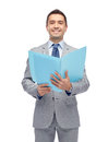 Happy businessman with open folder Royalty Free Stock Photo