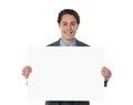 Happy businessman showing an emty billboard Royalty Free Stock Photos