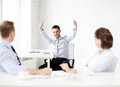 Happy businessman showing thumbs up in office picture of Royalty Free Stock Photography