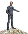 Happy businessman shows the way how to make a lot of money hospitable person standing on pile banknotes isolated on white Royalty Free Stock Photos