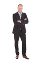 Happy businessman standing arms crossed Royalty Free Stock Photo