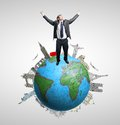 Happy businessman standing earth monuments Stock Photo