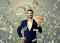 Happy businessman standing under money rain smiley and holding euro Stock Images