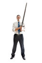 Happy businessman with sword a young on a white background holding a steel Royalty Free Stock Photo