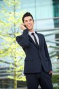 Happy businessman talking on mobile phone outdoors portrait of a Royalty Free Stock Image