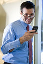 Happy businessman texting on mobile phone Stock Images