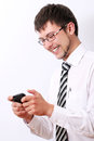 Happy businessman typing sms on his cellphone Stock Photo
