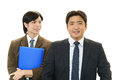 Happy businessmen the male office workers who poses happily Stock Photo