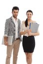 Happy businesspeople with files and laptop Royalty Free Stock Photo