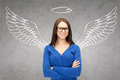 Happy businesswoman with angel wings and nimbus Royalty Free Stock Photo