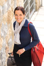 Happy businesswoman arriving home traveling luggage tired Stock Photo