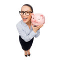 Happy businesswoman in eyeglasses with piggy bank business banking investment and office concept laughing Royalty Free Stock Photo