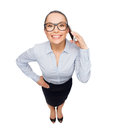 Happy businesswoman in eyeglasses with smartphone Stock Photography