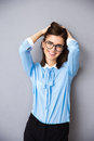 Happy businesswoman in glasses over gray background Royalty Free Stock Photo